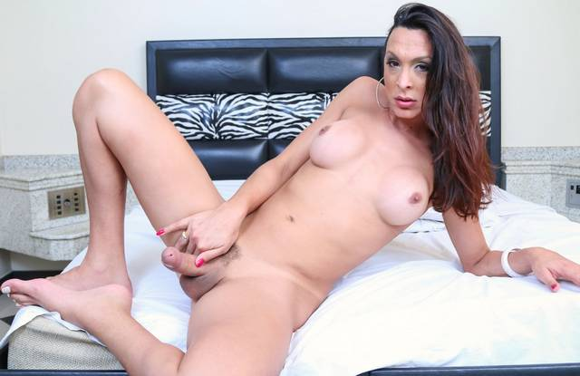 Teasing of hot tranny on the bed